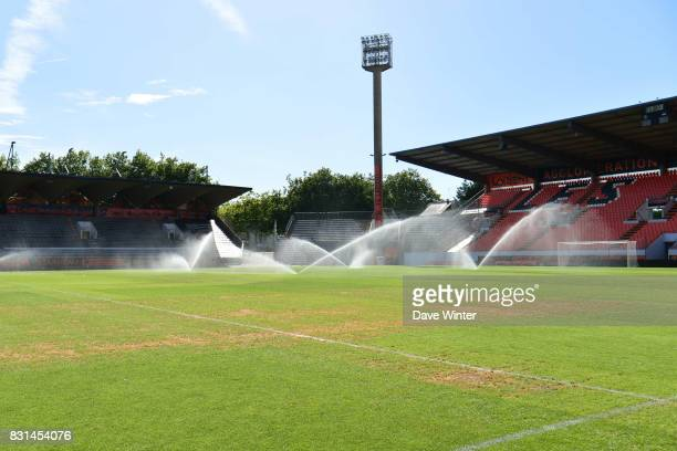 The pitch in a bad state following the ten day InterCeltique Festival receives a watering before the Ligue 2 match between FC Lorient and Chateauroux...