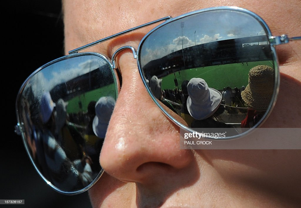 The pitch is reflected in the glasses of a fan during the Pool B match between Asutralia and the Netherlands at the Men's Hockey Champioships Trophy in Melbourne on December 2, 2012. IMAGE STRICTLY RESTRICTED TO EDITORIAL USE - STRICTLY NO COMMERCIAL USE AFP PHOTO/Paul CROCK