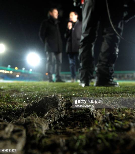 The pitch is seen as Manager of Borussia Dortmund Michael Zorc gives an interview on the background during heavy snow fall in Lotte Germany on...