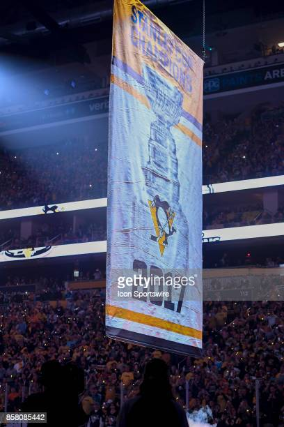 The Pittsburgh Penguins 2017 Stanley Cup Champions banner is raised to the rafters before the NHL game between the Pittsburgh Penguins and the St...