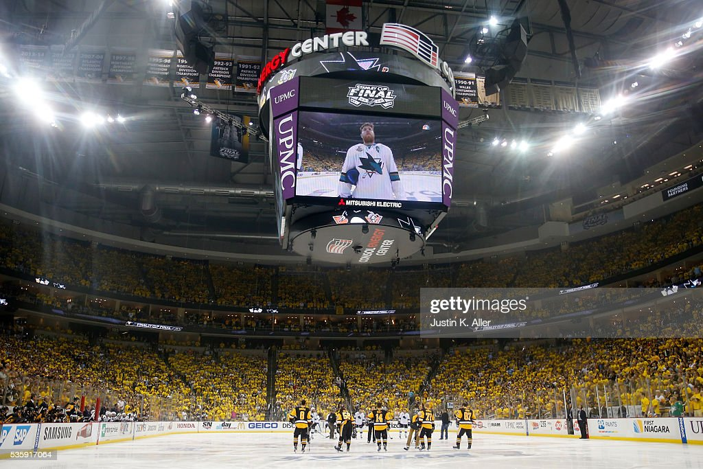 The Pittsburgh Penguins and the San Jose Sharks stand on the ice during player introductions prior to Game One of the 2016 NHL Stanley Cup Final at Consol Energy Center on May 30, 2016 in Pittsburgh, Pennsylvania.