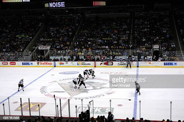 The Pittsburgh Penguins and the St Louis Blues play 3 on 3 in overtime during the game at Consol Energy Center on November 25 2015 in Pittsburgh...