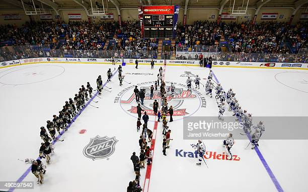 The Pittsburgh Penguins and the Tampa Bay Lightning stand on the ice for the signed jersey presentation after the Penguins defeated the Lightning 42...