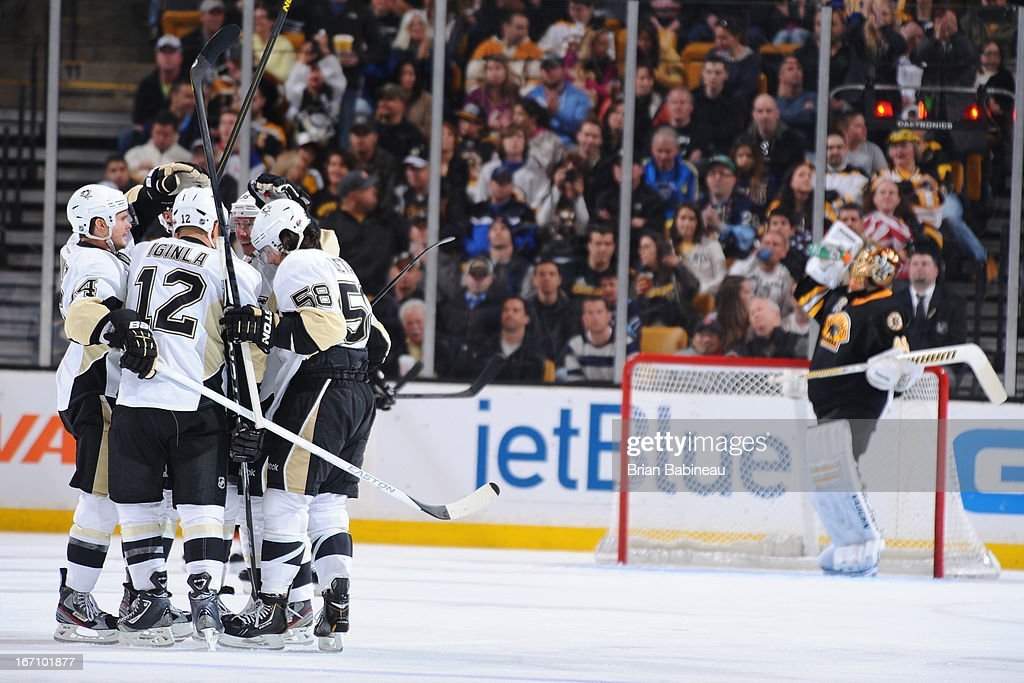 The Pittsburgh Penguins celebrate a goal against the Boston Bruins at the TD Garden on April 20, 2013 in Boston, Massachusetts.
