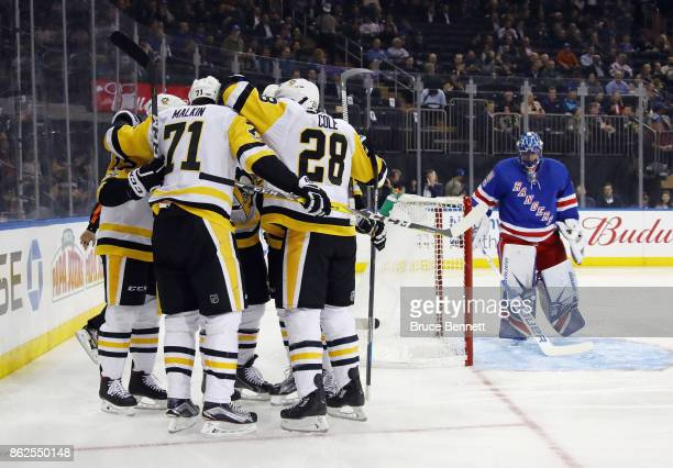 The Pittsburgh Penguins celebrate a goal by Phil Kessel at 47 seconds of the first period against Henrik Lundqvist of the New York Rangers at Madison...