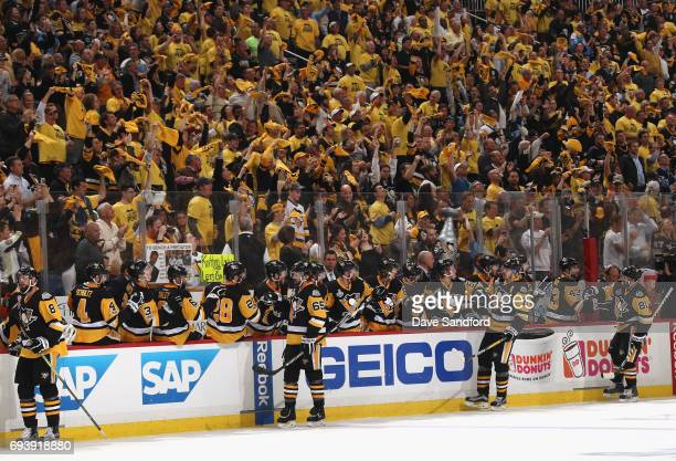 The Pittsburgh Penguins celebrate a goal by teammate Evgeni Malkin during the first period of Game Five of the 2017 NHL Stanley Cup Final against the...