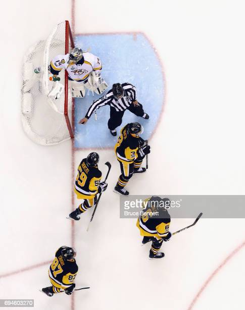 The Pittsburgh Penguins celebrate a goal on Juuse Saros of the Nashville Predators in Game Five of the 2017 NHL Stanley Cup Final at the PPG PAINTS...