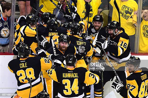The Pittsburgh Penguins celebrate after Conor Sheary scored the gamewinning goal against Martin Jones of the San Jose Sharks to win 21 in overtime...