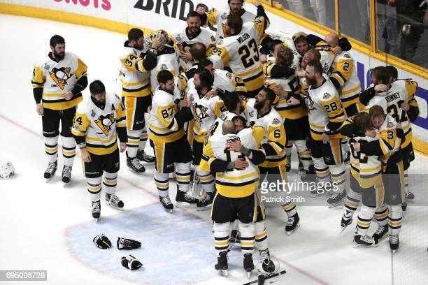 The Pittsburgh Penguins celebrate after defeating the Nashville Predators 20 to win the 2017 NHL Stanley Cup Final at the Bridgestone Arena on June...