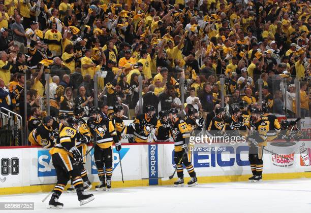 The Pittsburgh Penguins celebrate after Jake Guentzel scored the gamewinning goal against the Nashville Predators during the third period of Game One...