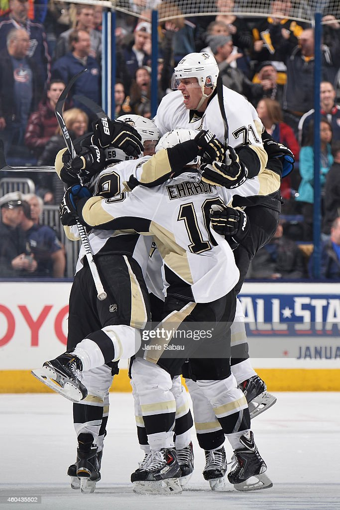 The Pittsburgh Penguins celebrate after scoring a gametying goal late in the third period of a game against the Columbus Blue Jackets on December 13...