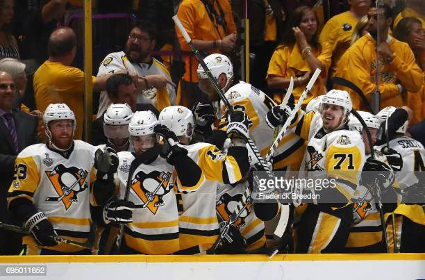 The Pittsburgh Penguins celebrate after scoring a goal against the Nashville Predators during the third period in Game Six of the 2017 NHL Stanley...
