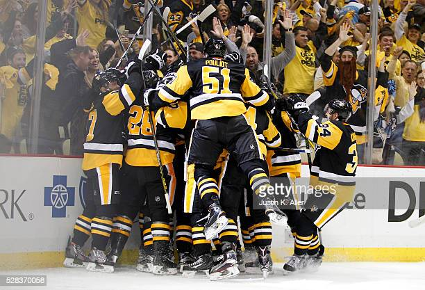The Pittsburgh Penguins celebrate with Patric Hornqvist of the Pittsburgh Penguins after scoring the gamewinning goal in overtime against the...
