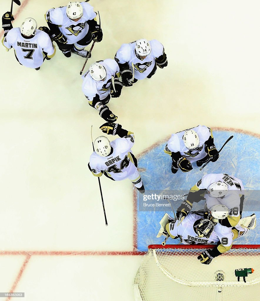 The Pittsburgh Penguins congratulate <a gi-track='captionPersonalityLinkClicked' href=/galleries/search?phrase=Tomas+Vokoun&family=editorial&specificpeople=202179 ng-click='$event.stopPropagation()'>Tomas Vokoun</a> #92 on a victory over the New York Islanders at Nassau Veterans Memorial Coliseum on March 22, 2013 in Uniondale, New York. The Penguins defeated the Islanders 4-2.