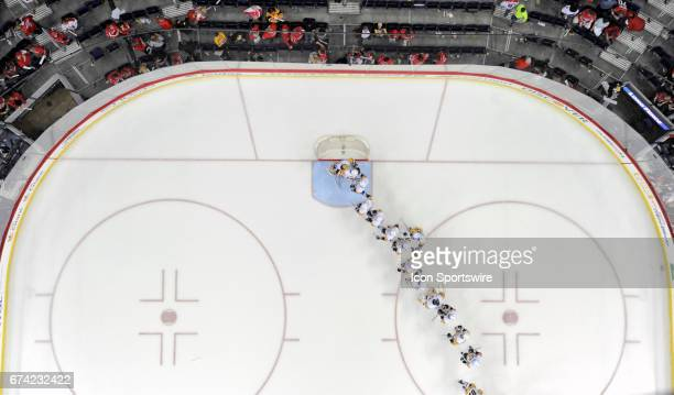 The Pittsburgh Penguins line up to congratulate Pittsburgh Penguins goalie MarcAndre Fleury following the game against the Washington Capitals on...