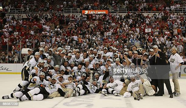 The Pittsburgh Penguins pose with the Stanley Cup following the Penguins victory over the Detroit Red Wings in Game Seven of the 2009 NHL Stanley Cup...