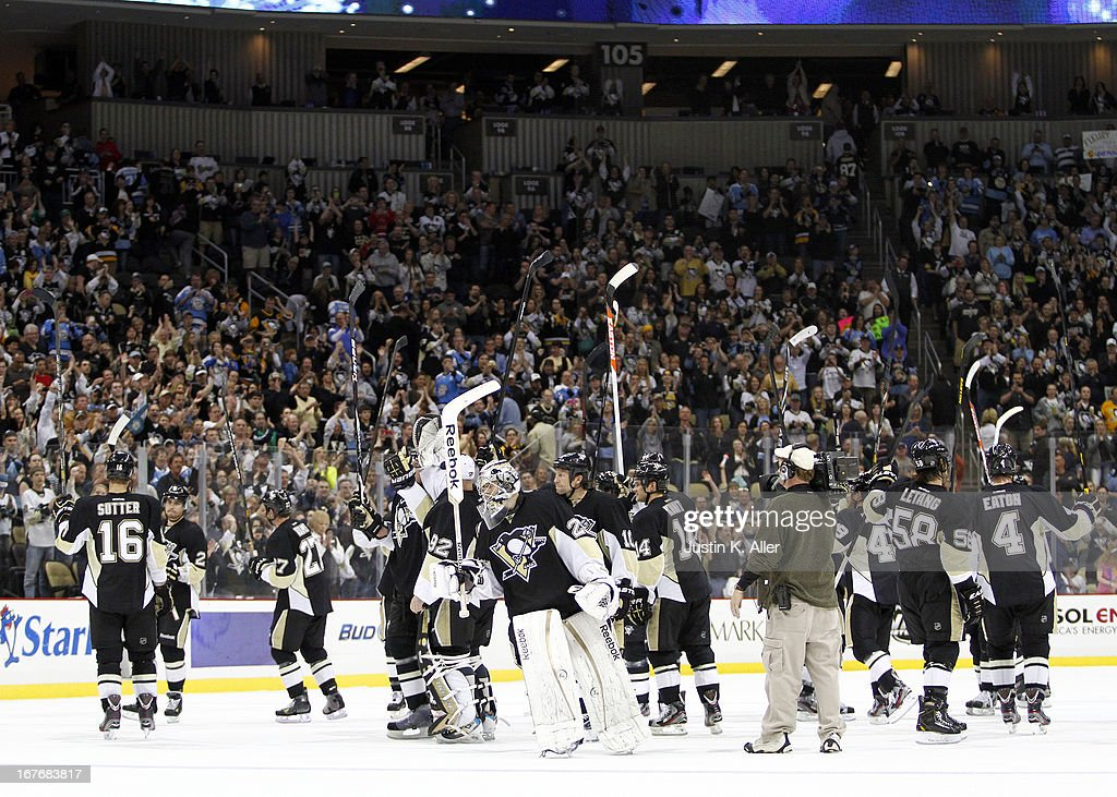 The Pittsburgh Penguins salute the fans after defeating the Carolina Hurricanes at Consol Energy Center on April 27, 2013 in Pittsburgh, Pennsylvania. The Penguins defeated the Hurricanes 8-3.
