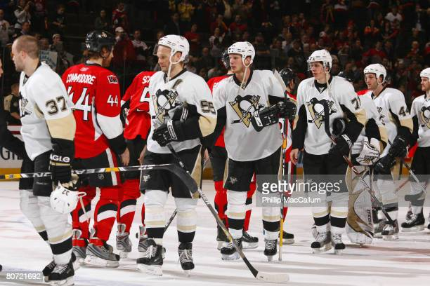 The Pittsburgh Penguins shake hands with the Ottawa Senators after a fourgame sweep and a series victory in their 2008 Eastern Conference...