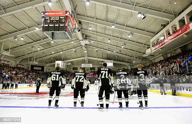 The Pittsburgh Penguins starting line up stands on the ice during the singing of the national anthem before playing n the NHL Kraft Hockeyville USA...