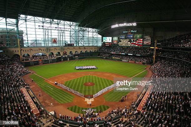 The Pittsburgh Pirates and the Houston Astros line up on the field for the singing of the National Anthem prior to their opening day game on April 2...