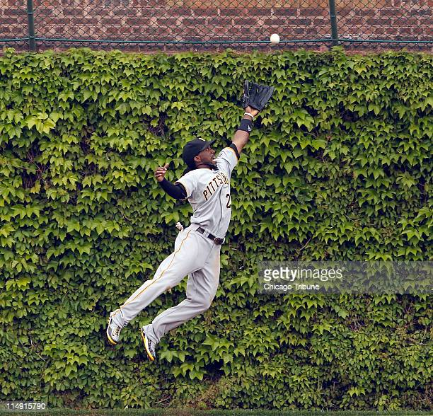 The Pittsburgh Pirates' Andrew McCutchen can't reach a double by Chicago Cubs Alfonso Soriano during the fifth inning at Wrigley Field in Chicago...