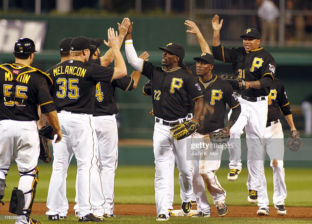 The Pittsburgh Pirates celebrate after defeating the St. Louis Cardinals on July 31, 2013 at PNC Park in Pittsburgh, Pennsylvania. The Pirates defeated the Cardinals 5-4.