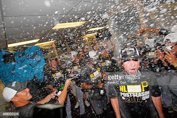 The Pittsburgh Pirates celebrate clinching a National League playoff spot after their 32 win over the Atlanta Braves at Turner Field on September 23...