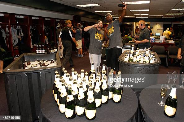 The Pittsburgh Pirates celebrate clinching a playoff spot after their 137 victory over the Colorado Rockies at Coors Field on September 23 2015 in...