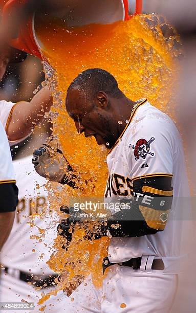 The Pittsburgh Pirates celebrate with Starling Marte after hitting a solo walk off home run in the ninth inning during the game against the San...