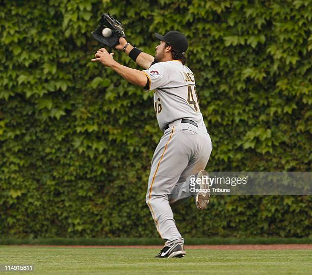 The Pittsburgh Pirates' Garrett Jones catches a fly out hit by the Chicago Cubs' Aramis Ramirez during the seventh inning at Wrigley Field in Chicago...