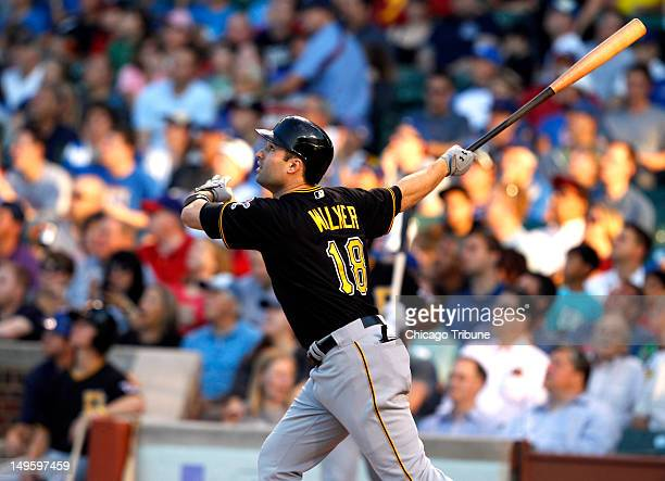 The Pittsburgh Pirates' Neil Walker watches the flight of his grand slam against the Chicago Cubs in the first inning at Wrigley Field in Chicago...