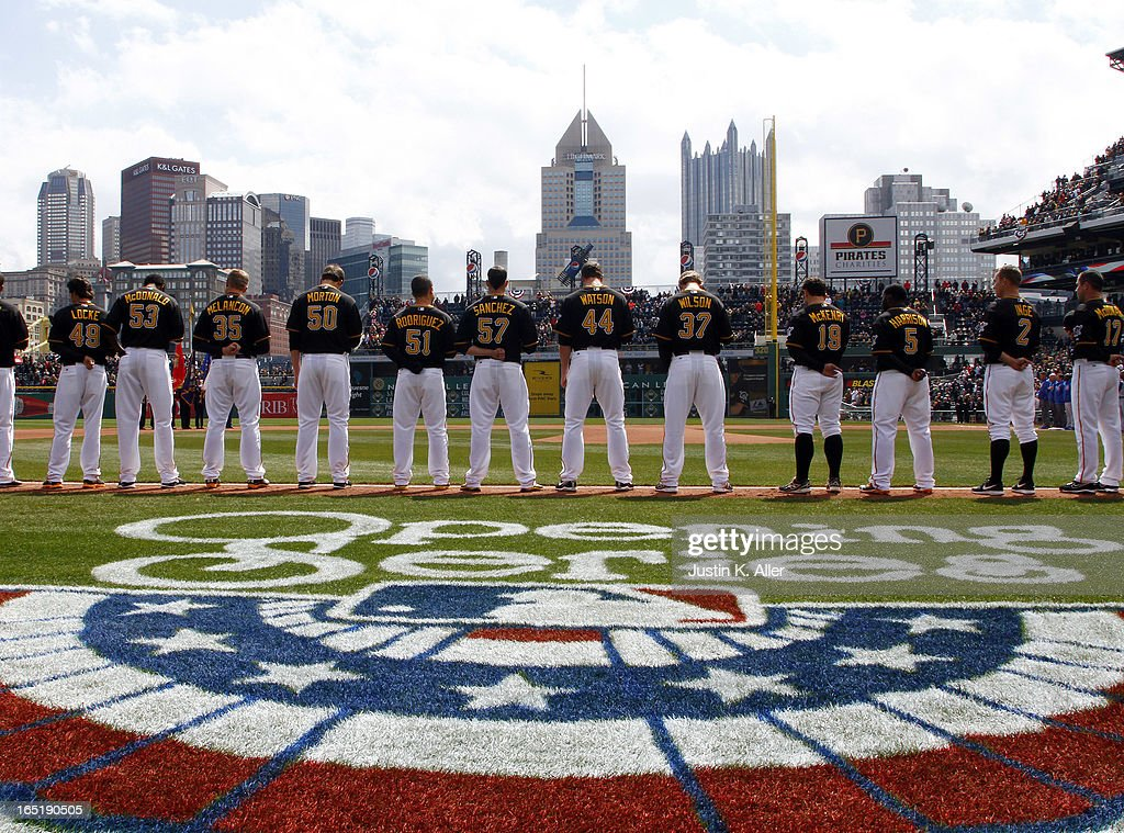 The Pittsburgh Pirates stand during pre-game ceremonies before the opening day game against the Chicago Cubs on April 1, 2013 at PNC Park in Pittsburgh, Pennsylvania.
