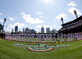 The Pittsburgh Pirates stand during the national anthem during opening day against the St Louis Cardinals at PNC Park on April 3 2016 in Pittsburgh...