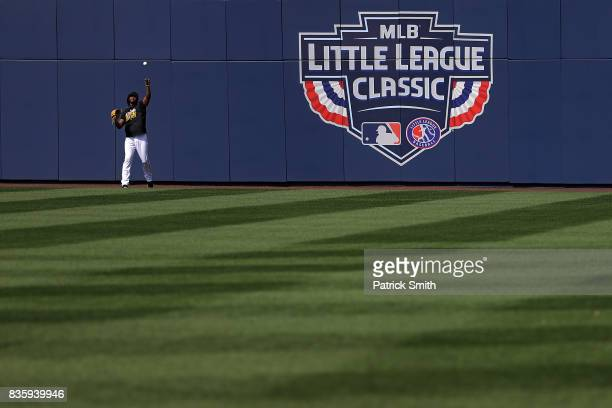 The Pittsburgh Pirates warmup before playing the St Louis Cardinals in the inaugural MLB Little League Classic at BBT Ballpark at Historic Bowman...