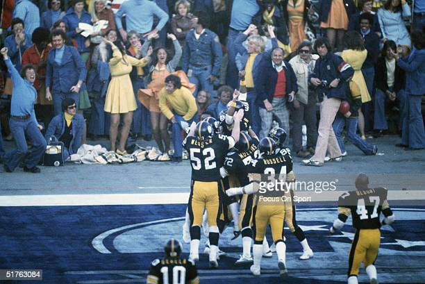 The Pittsburgh Steelers gather at the end zone to congratulate Franco Harris during Super Bowl X against the Dallas Cowboys at the Orange Bowl on...