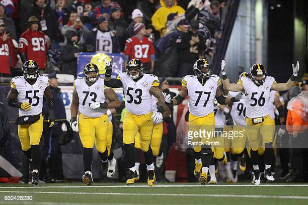 The Pittsburgh Steelers run on to the field prior to the AFC Championship Game against the New England Patriots at Gillette Stadium on January 22...
