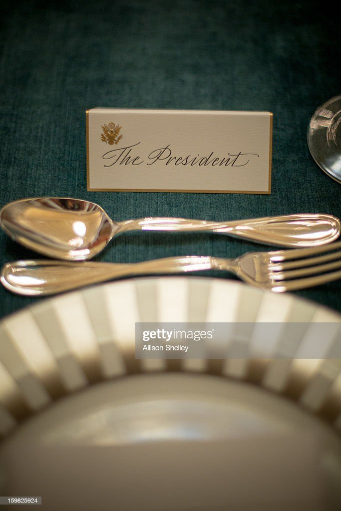 The place card for U.S. President Barack Obama is ready for the Inaugural Luncheon in Statuary Hall on Inauguration day at the U.S. Capitol building January 21, 2013 in Washington D.C. U.S. President Barack Obama will be ceremonially sworn in for his second term today.