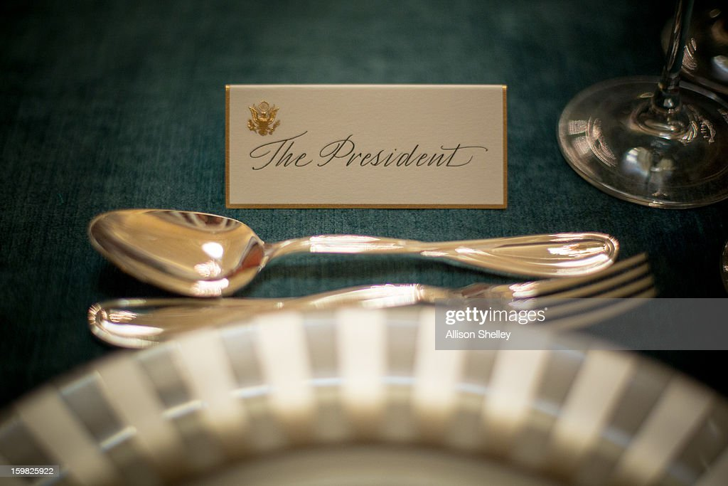 The place card for U.S. President Barack Obama sits ready for the Inaugural Luncheon in Statuary Hall on inauguration day at the U.S. Capitol building January 21, 2013 in Washington D.C. U.S. President Barack Obama, will be ceremonially sworn in for his second term today.