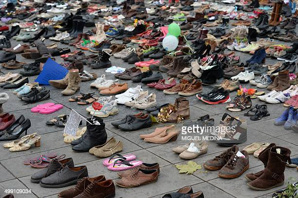 The Place de la Republique is covered in hundreds of pairs of shoes on November 29 2015 in downtown Paris as part of a symbolic and peaceful rally...