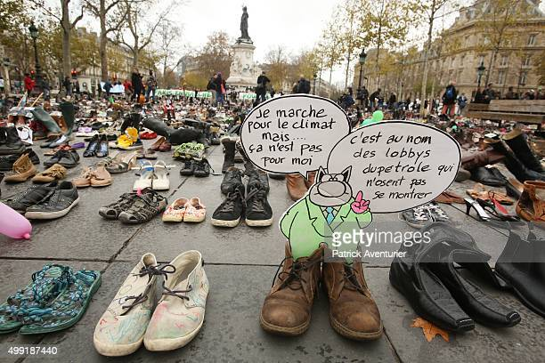 The place de la Republique is covered with shoes as part of symbolic rally organized by the NGO Avaaz during the forbidden COP21 demonstration on...