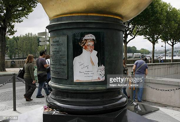 The Place de l'Alma with its reproduction of New York's Statue of Liberty flame in Paris August 22 has become an unofficial memorial for the tragic...