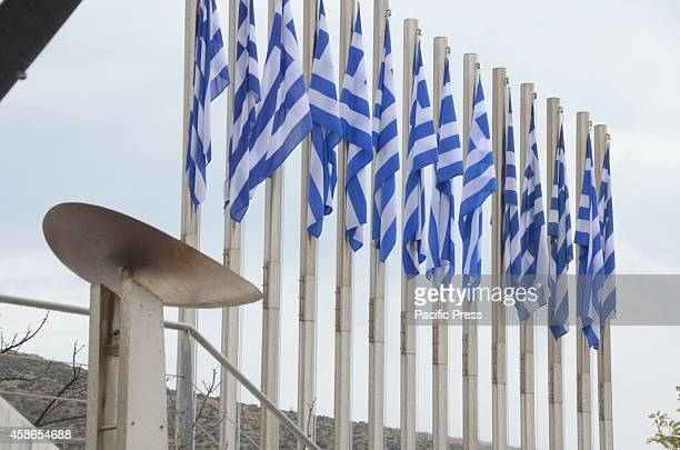 The place of the Marathon fire is seen with Greek flags on the Background0n Marathon SEGAS organisation did the ceremony of the Lighting of the...