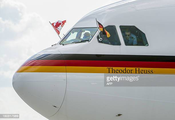 The plane carrying German Chancellor Angela Merkel arrives at the MacdonaldCartier International Airport in Ottawa Ontario Canada Merkel arrived in...