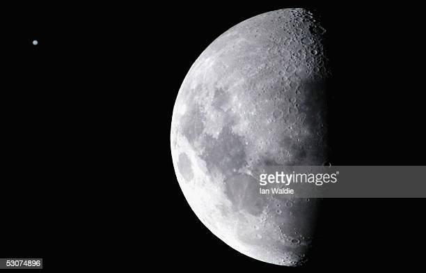 The planet Jupiter appears as a faint disc next to the moon June 16 2005 in Sydney Australia The phenomenon which occurs every few years is caused...
