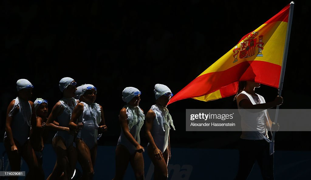 The plankton children follow the Spanish flag bearer during the Opening Ceremony of the 15th FINA World Championships at Palau Sant Jordi on July 19, 2013 in Barcelona, Spain.