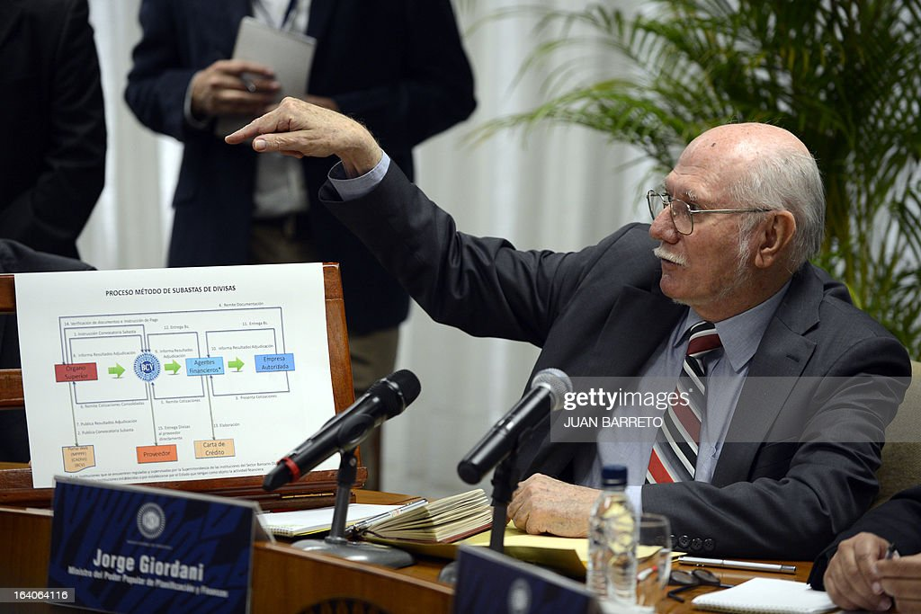 The Planning and Finance Minister Jorge Giordani speaks during a press conference in Caracas on March 19, 2013. AFP PHOTO