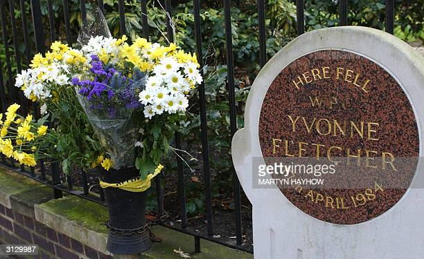 The plaque erected to WPC Yvonne Fletcher stands in St James Square London decorated with fresh flowers 25 March 2004 almost twenty years after she...