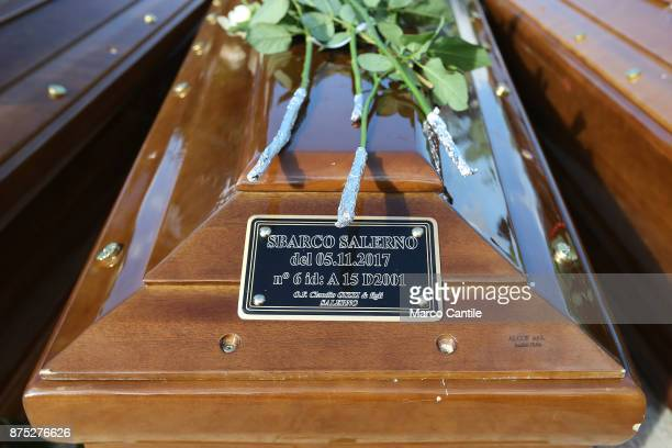 The plaque on one of the bars with written 'Salerno Landing' during the funeral of the 28 migrant women who died in a shipwreck as they sought to...