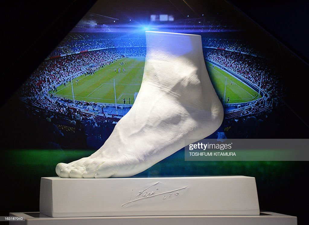 The plaster-made replica of football star Lionel Messi of Argentine's left foot is on display during its press preview in Tokyo on March 6, 2013. Priced at about 5.25 million USD, the 25-kilogram golden foot was created by Tokyo-based jewelry retailer, Ginza Tanaka, to commemorate Messi's record-breaking Ballon d'Or for four consecutive years and the world-record 91 goals he scored a calender year.