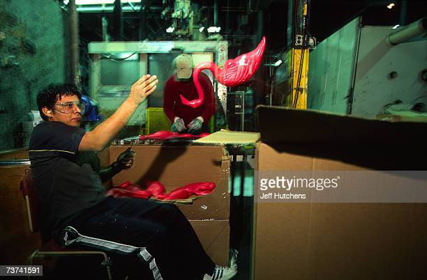 The plastic pink flamingo is handled by factory workers who file down the rough edges during the flamingo's production at Union Products on March 18...